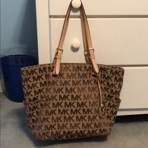 Brown and tan MK Michael Kors bag